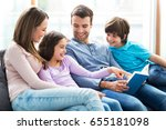 happy family reading book... | Shutterstock . vector #655181098