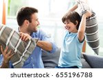 father and son having pillow... | Shutterstock . vector #655196788