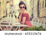 young woman having italian... | Shutterstock . vector #655215676