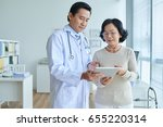 concentrated asian cardiologist ... | Shutterstock . vector #655220314