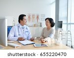 middle aged asian doctor... | Shutterstock . vector #655220470