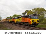 Small photo of SHRIVENHAM, UK - MAY 12: A convoy of class 70 diesel locos operated by Colas Rail head toward Bescot depot leading an engineers infrastructure train on May 12, 2015 in Shrivenham