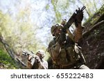 two men engaged in airsoft | Shutterstock . vector #655222483