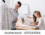 charming young tailors working... | Shutterstock . vector #655264066
