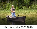Fisherman Is Standing In The...