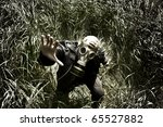 man with gas mask in the grass   Shutterstock . vector #65527882