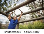 fit man climbing monkey bars... | Shutterstock . vector #655284589