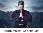 martial arts fighter meditates | Shutterstock . vector #655285039