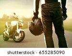 motorbiker standing in front of ...   Shutterstock . vector #655285090