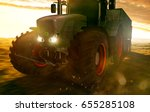 tractor drives over a field | Shutterstock . vector #655285108