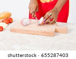 hands of woman cutting onions...