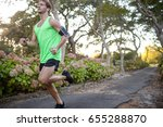 jogger jogging on pathway in... | Shutterstock . vector #655288870