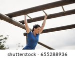 fit woman climbing monkey bars... | Shutterstock . vector #655288936