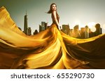 woman with golden dress | Shutterstock . vector #655290730