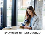 woman holding tablet and... | Shutterstock . vector #655290820