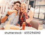 dating in pizzeria. handsome... | Shutterstock . vector #655296040