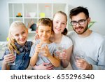 family drinks water | Shutterstock . vector #655296340
