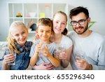 family drinks water | Shutterstock . vector #655296340