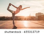 sporty girl is doing yoga on a... | Shutterstock . vector #655313719