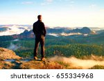 tourist on the cliff of rock in ... | Shutterstock . vector #655334968