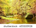 colors of autumn mountain river.... | Shutterstock . vector #655335928