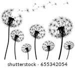 silhouette of a dandelion on a... | Shutterstock .eps vector #655342054