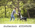 hipster son walking with... | Shutterstock . vector #655349698