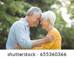 happy senior couple enjoying in ... | Shutterstock . vector #655360366