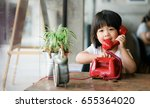 asian little girl talking on... | Shutterstock . vector #655364020