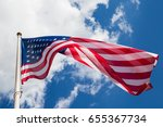 American Flag Against A Blue...