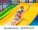 Father and son on a water slide ...