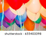 colored balloons with helium | Shutterstock . vector #655403398