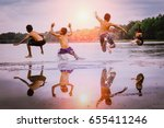 young boys jumping into the... | Shutterstock . vector #655411246