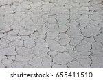 dry soil crack surface... | Shutterstock . vector #655411510
