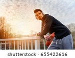 jogger resting after exercise... | Shutterstock . vector #655422616