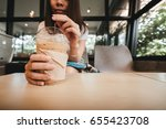 young woman drinking coffee in... | Shutterstock . vector #655423708