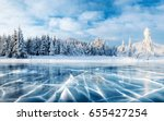 blue ice and cracks on the... | Shutterstock . vector #655427254