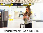 young woman at the airport with ... | Shutterstock . vector #655431646