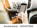 driver using smart phone in the ...   Shutterstock . vector #655437004