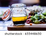 a glass bottle with salad... | Shutterstock . vector #655448650