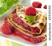 pancake with raspberries and mint - stock photo