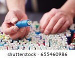 tailor choosing thread color... | Shutterstock . vector #655460986