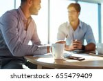 business executives discussing... | Shutterstock . vector #655479409