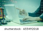 man typing keyboard laptop hand.... | Shutterstock . vector #655492018