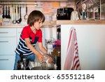preschool child  boy  helping... | Shutterstock . vector #655512184