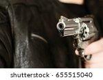 man with hand gun pistol rubber ... | Shutterstock . vector #655515040