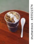 Small photo of Acai berry in cup with nuts and baked grains