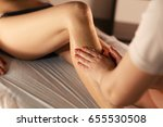 young woman having feet and... | Shutterstock . vector #655530508