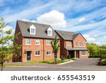 red brick english houses | Shutterstock . vector #655543519
