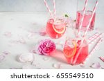 Stock photo summer refreshment drinks light pink rose cocktail with rose wine tea rose petals lemon on a 655549510